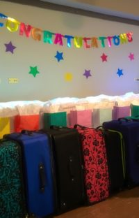 Gifts lined up for 18-year-olds at an Age of Majority celebration.